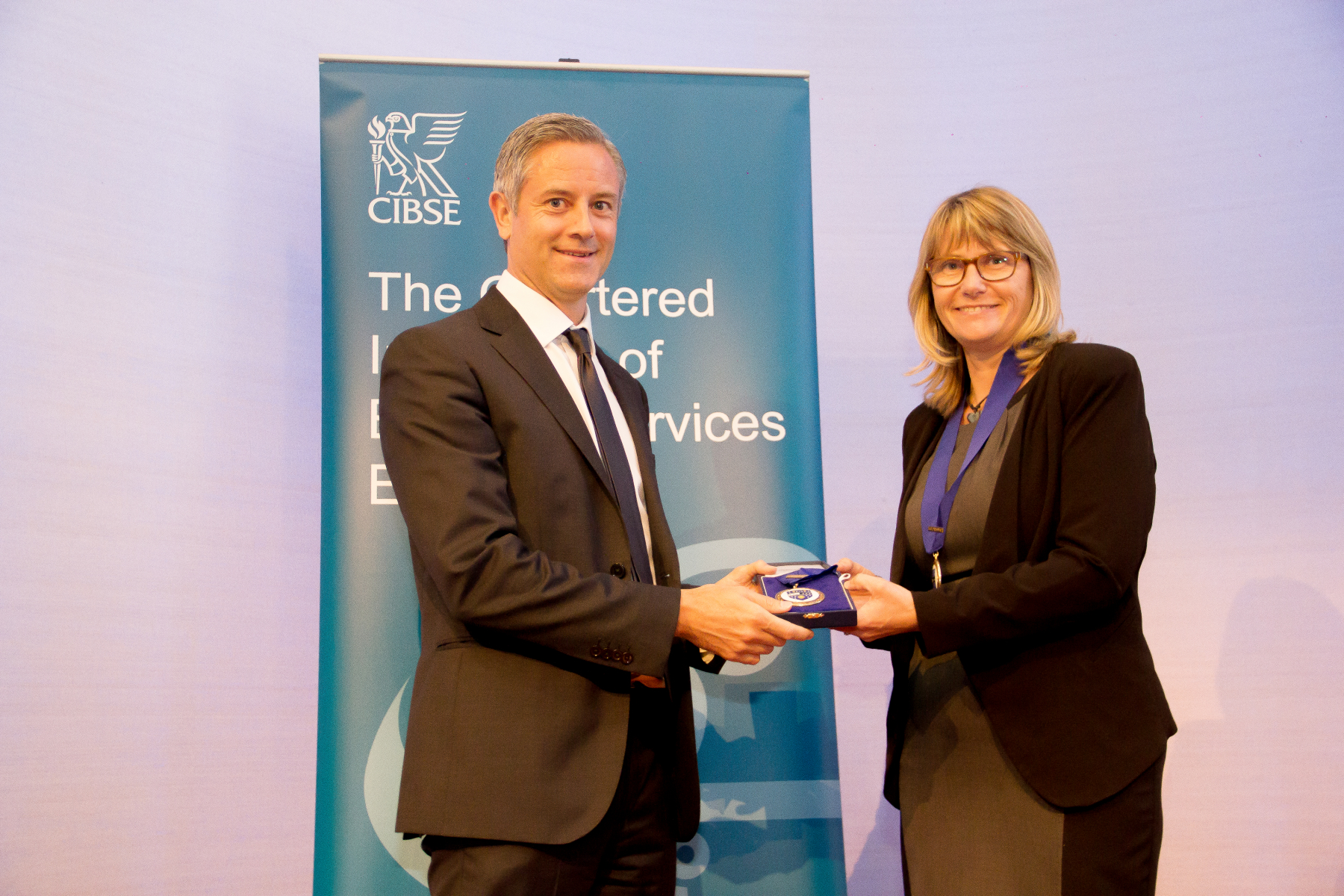 Ashley receiving Vice Presidency medal from Professor Lynne Jack